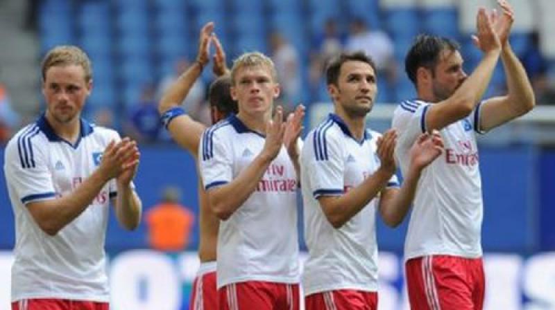 Artjoms Rudņevs ar komandas biedriem Foto: mopo.de/Witters