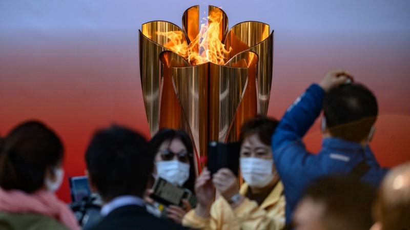 Japānā pirmajā dienā olimpisko uguni klātienē vērojuši vairāk nekā 55 tūkstoši